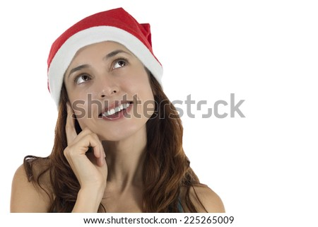 Happy looking Christmas woman thinking and dreaming - stock photo
