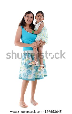 happy looking south asian indian mother and daugther - stock photo