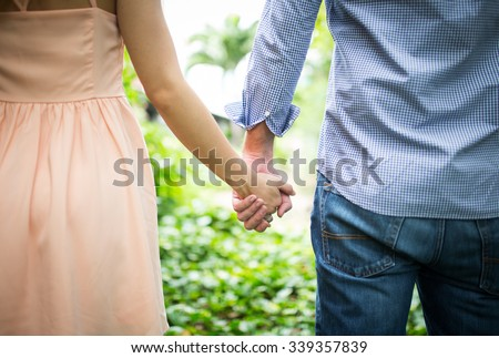 Happy love  couple holding hands in the morning at outdoor - stock photo