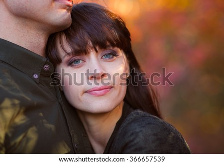 Happy love couple in beautiful autumn day - stock photo