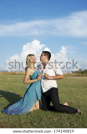 Happy love couple in the green field