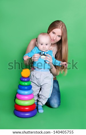 Happy love family - beautiful mother hug her son, posing on background in studio closeup - stock photo