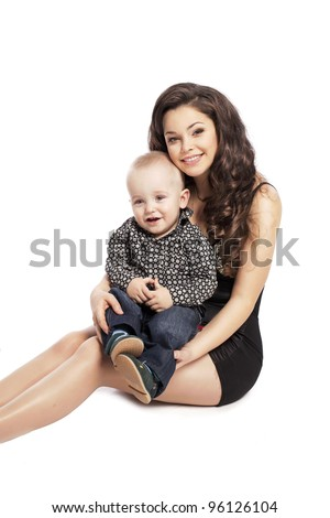 Happy love family - beautiful mother hug her son, posing on white background in studio closeup - stock photo
