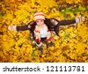 happy lovely and beautiful woman in forest in fall colors, celebrating coming autumn - stock photo