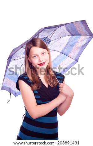 Happy lovely teen girl staying under umbrella and smiling - stock photo