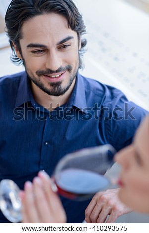 Happy loving couple dating in restaurant - stock photo