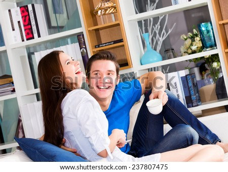 Happy loving couple in a living room - stock photo