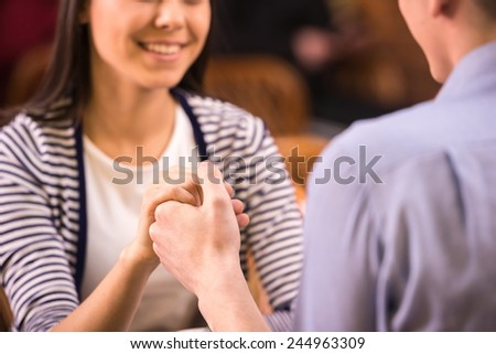 Happy loving couple in cafe, man and woman at romantic dating. - stock photo