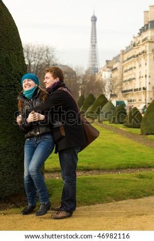 Happy loving couple in Paris, having fun outdoors - stock photo