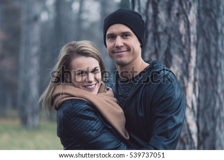 Happy loving couple in park. Outdoor portrait of young couple.