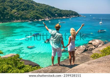 Happy Loving couple on a tropical beach against the sea Similan Island - stock photo