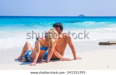 Happy Loving couple on a tropical beach against the sea Similan Island