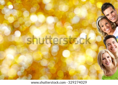 Happy loving couple over golden banner background.
