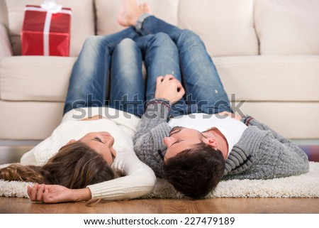 Happy loving couple vacation home, view from above - stock photo