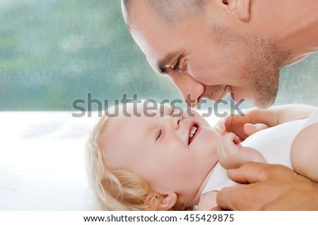 Happy loving family. Father and his baby child playing and hugging. Daddy and his toddler girl. Pastel studio background and space for text. - stock photo