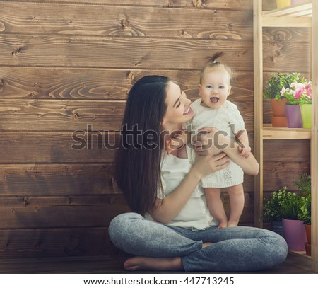 Happy loving family. Mother and her child baby girl playing in the summer day. - stock photo