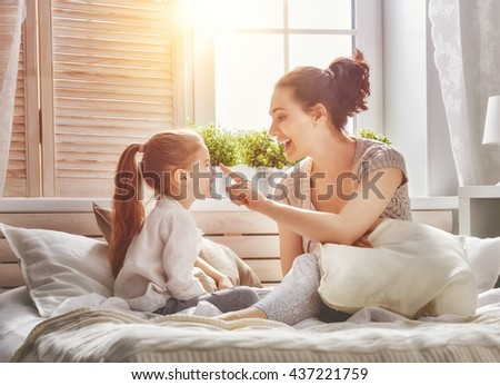 Happy loving family. Mother and her daughter child girl playing together. - stock photo