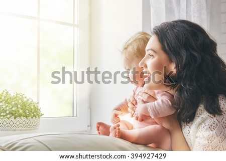 happy loving family. mother playing with her baby in the living room. - stock photo