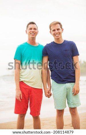Happy loving gay couple on the beach