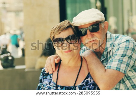 Happy loving senior couple enjoying vacation together - stock photo