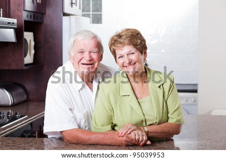 happy loving senior couple portrait at home - stock photo