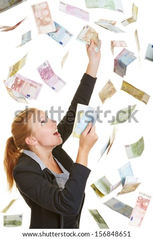 Happy lucky business woman catching flying Euro money banknotes - stock photo