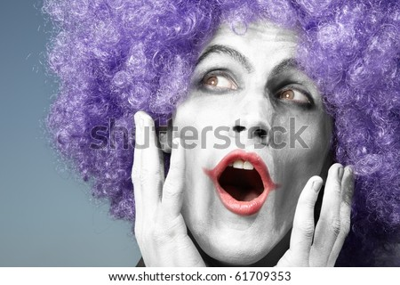 Happy mad clown singing song on a blue background - stock photo