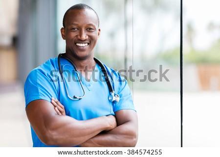 happy male african medical surgeon looking at the camera