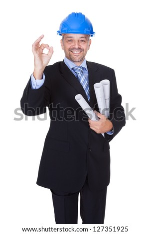 Happy Male Architect Offering Handshake On White Background - stock photo