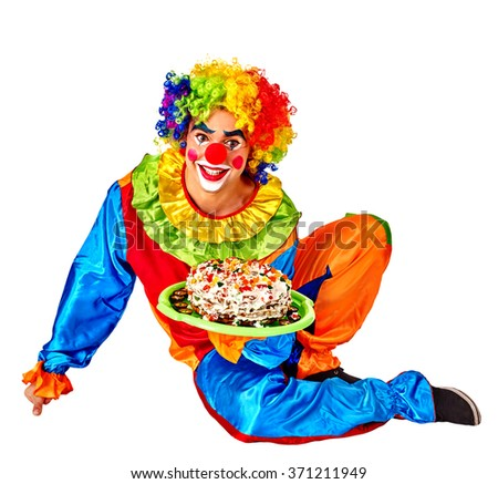 Happy male birthday clown holding cake.  Chidhood concept. Isolated. - stock photo