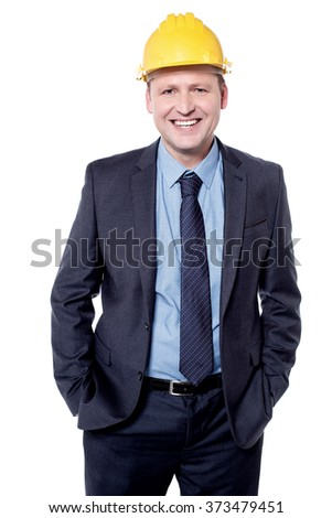 Happy male engineer posing with hands in pocket - stock photo
