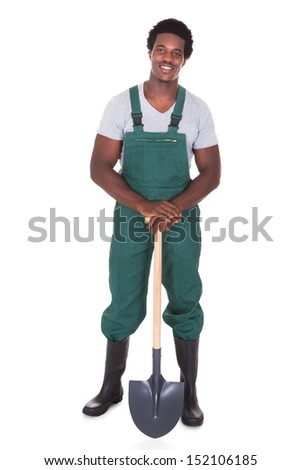 Happy Male Gardener Holding Shovel Over White Background