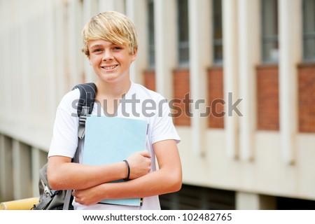 happy male high school student portrait in school - stock photo