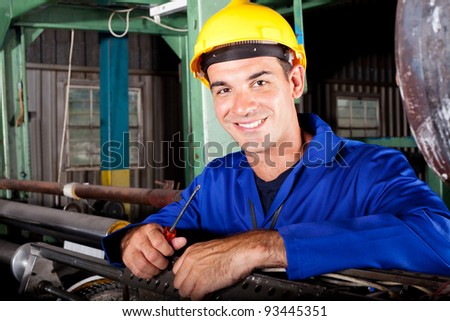 happy male industrial mechanic at work - stock photo