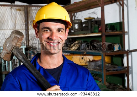 happy male manual worker in factory - stock photo