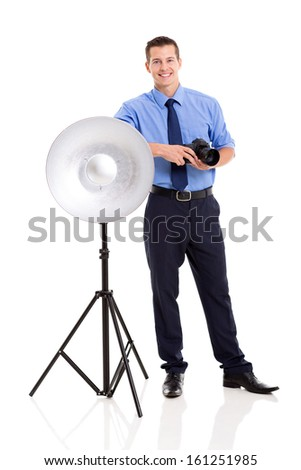 happy male photographer in studio standing next to beauty dish - stock photo