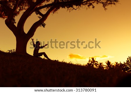Happy male raising his arms up in a beautiful outdoor setting.  - stock photo