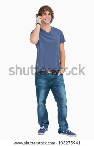 Happy male student on the phone against white background - stock photo