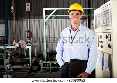happy male technician in factory