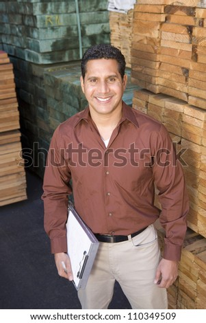 Happy male worker in the warehouse - stock photo