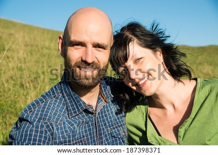 happy man and happy woman outdoors - stock photo