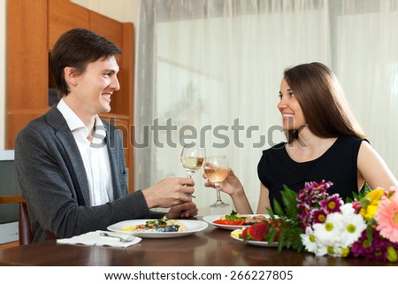 Happy man and woman having romantic dinner in home - stock photo