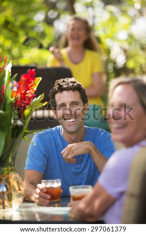 Happy man and woman on with drinks in Maui - stock photo