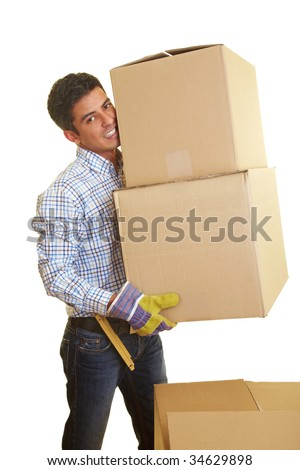 Happy man carrying two boxes - stock photo