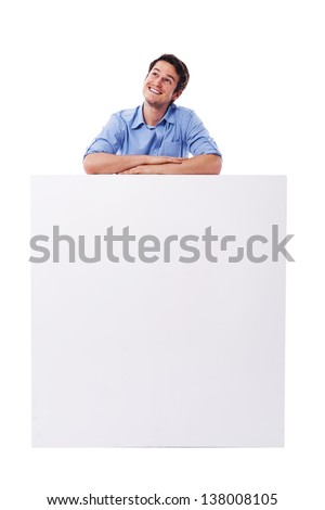 Happy man dreaming about something - stock photo
