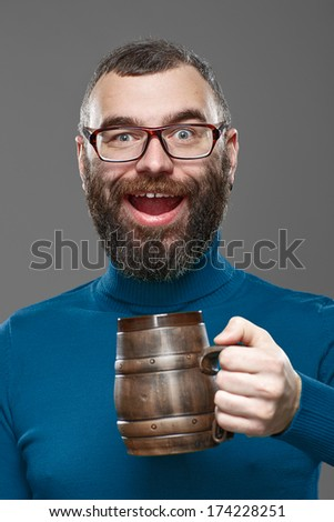 Happy man drinking beer from a beer mug - stock photo