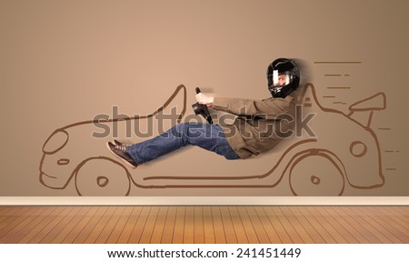 Happy man driving an hand drawn car on the wall concept - stock photo