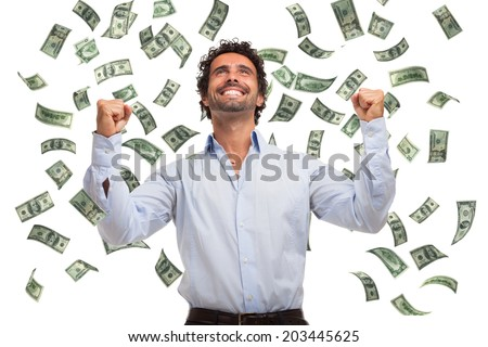 Happy man enjoying a rain of money