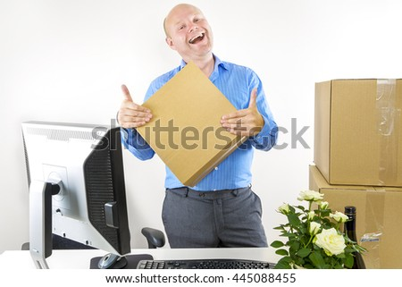 Happy man has first day of work - stock photo