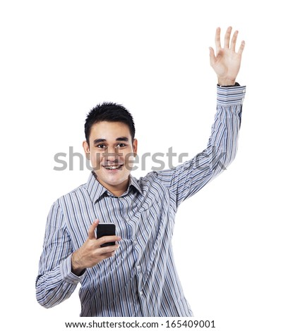 Happy man holding a smart phone. Isolated on white background - stock photo